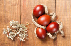 Paschal eggs on wooden background Royalty Free Stock Photo