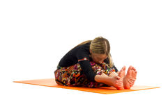 Paschimottanasana, a position in Yoga, is also called  Seated Forward Bend Royalty Free Stock Images