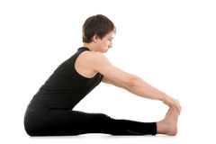 Paschimottanasana yoga pose Stock Image
