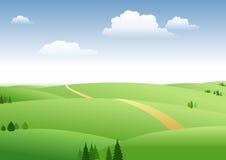 Pascolo e cielo blu Fotografia Stock