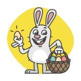 Pascua Bunny Holds Egg y cesta con los huevos Imágenes de archivo libres de regalías