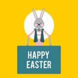 Pascua feliz Conejo de la historieta con las muestras en un fondo amarillo Foto de archivo