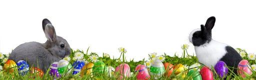 Pasen-achtergrond met paaseieren en Paashazen Royalty-vrije Stock Afbeelding