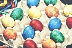 Pasen, kleurden de paaseieren, kartondoos, linten, Grote Sunda Royalty-vrije Stock Fotografie