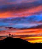 Pasen-zonsonderganghemel met kruisen, Christen Stock Afbeelding