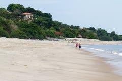 Paseo abajo de la playa Foto de archivo libre de regalías
