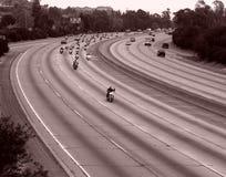 Paseo de la motocicleta en una autopista sin peaje Foto de archivo libre de regalías
