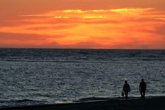 Paseo de la puesta del sol Imágenes de archivo libres de regalías