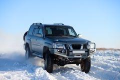 Paseo de SUV del invierno Imagen de archivo
