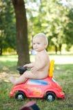 Paseo del bebé en el coche del juguete Imagen de archivo libre de regalías