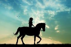Paseo del caballo en la puesta del sol Imágenes de archivo libres de regalías