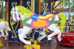 Paseo del carrusel con los caballos Imagenes de archivo