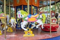 Paseo del carrusel con los caballos Fotografía de archivo libre de regalías