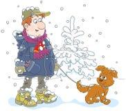 Paseo del invierno con un perro Foto de archivo