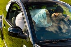 Paseo feliz del coche Imagenes de archivo