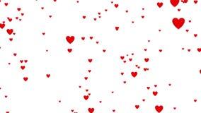 Paseo linear a través de porciones de lluvia roja minúscula de los corazones con el efecto de Defocus