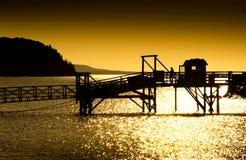 Paseo marítimo en la salida del sol Fotos de archivo