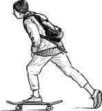 paseos adolescentes en un monopatín Fotografía de archivo