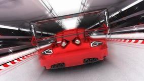 Paseos rojos del coche deportivo en el circuito de la raza Imagen de archivo libre de regalías