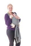 Pasgeboren baby in slinger stock afbeelding