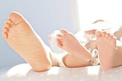 Pasgeboren babyvoeten Stock Foto