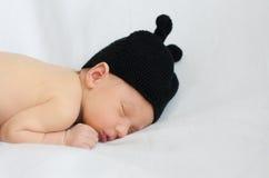 Pasgeboren in een lieveheersbeestjekostuum Stock Foto