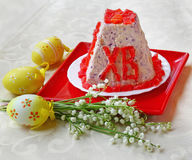 Pasha(paskha,pashka ) quark dessert for easter and bouquet of li Stock Photo
