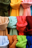 Pashminas of different colours. On street market royalty free stock image
