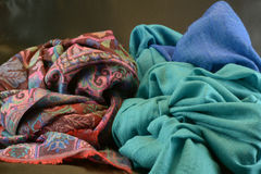 PASHMINE SCARF. FABRIC OF DIFFERENT COLOR,SCIARPE IN TESSUTO PASHMINE DI VARIA COLORAZIONE Stock Image