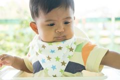 Pasian baby bored with food stock photos