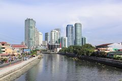 Pasig River Passing Rockwell & Makati in Manila Philippines. MANILA - JUNE 12: The pasig river in makati passing  by high rise condo buildings of Rockwell Stock Image