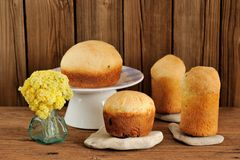 Paska, East European easter sweet breads with yellow flowers on Royalty Free Stock Image