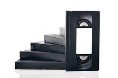 Paso de progresión de las videocintas en un fondo blanco fotografía de archivo libre de regalías