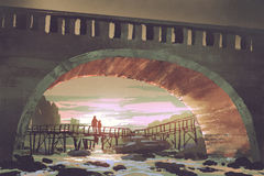 Paso del río debajo del puente viejo en la puesta del sol Foto de archivo libre de regalías