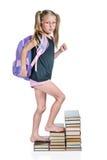 Pasos de la muchacha en las escaleras de los libros Fotografía de archivo libre de regalías