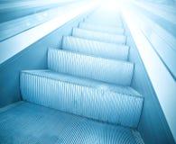 Pasos de progresión de la escalera móvil Imágenes de archivo libres de regalías