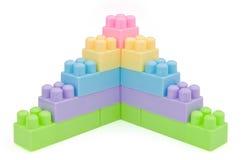 Pasos de progresión de los ladrillos del juguete Fotografía de archivo