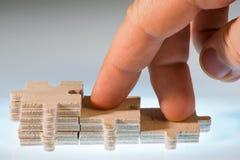 Pasos hechos de partes de madera del rompecabezas Imágenes de archivo libres de regalías