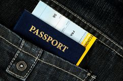Pasport with boarding pass in jeans Royalty Free Stock Photos