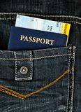Pasport with boarding pass in jeans Royalty Free Stock Images