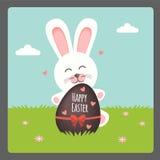 Pasqua felice con l'uovo di cioccolato e del coniglietto Fotografie Stock