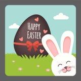 Pasqua felice con sorridere del coniglietto e l'uovo di cioccolato Immagine Stock Libera da Diritti