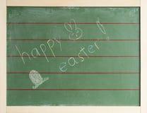Pasqua felice sta su una lavagna verde Fotografia Stock