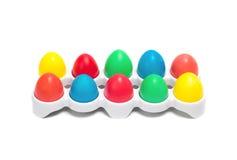 Pasqua ha colorato le uova in un piedistallo bianco Fotografia Stock Libera da Diritti
