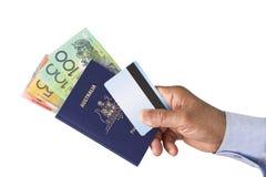 Pass-, bankATM-kreditkort och australiska dollar Arkivfoto