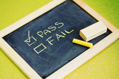 Pass or fail writing on blackboard Royalty Free Stock Image