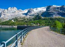 The Pass Fedaia 2054 m is denominated by the Fedaia Lake, a nuge 2 Km long , on the foot of the Marmolada glacier, the que stock images