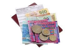 Pass med Hong Kong Dollar och ett ankomstkort Royaltyfria Bilder