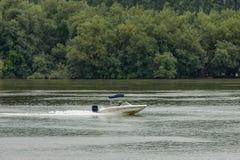 Pass a motor  boat  in the river Danube along Vidin port, Bulgaria Royalty Free Stock Photos