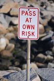 Pass at Own Risk Signage Royalty Free Stock Images
